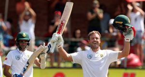 AB de Villiers rose his bat to celebrate a century